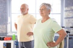 Elderly people doing exercises royalty free stock photo
