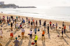 Elderly people doing exercises on the beach. Healthy lifestyle, active lifestyle retiree in Benidorm, Spain. Benidorm, Spain, January 29, 2018: Elderly people royalty free stock images