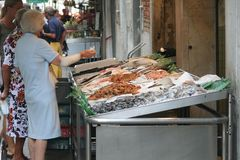 Elderly people at the fish market. Of Venice Italy royalty free stock images