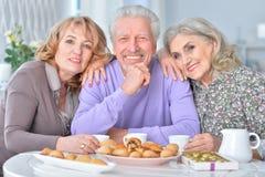 Elderly people having breakfast Royalty Free Stock Image