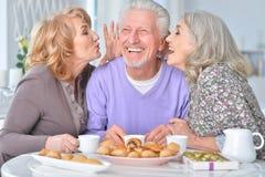 Elderly people having breakfast Stock Photo