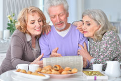 Elderly people having breakfast and reading a newspaper Stock Photo
