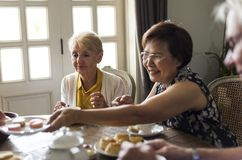 Elderly people having tea party together.  Royalty Free Stock Image