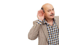 Elderly people with hearing loss tries to listen to the sounds Royalty Free Stock Photos