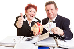 Elderly people holding money Royalty Free Stock Photo