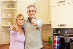 Elderly people holding thumbs up Royalty Free Stock Photos
