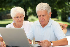 Elderly people and internet Stock Photos