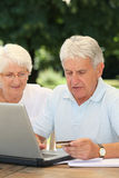 Elderly people and internet Stock Images