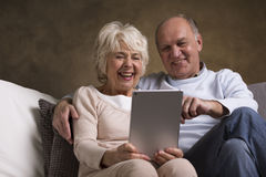 Elderly people with modern technology Stock Photos