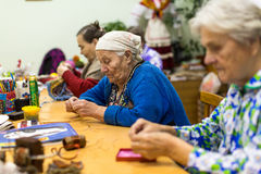 Elderly people during occupational therapy for eldery and disabled in rehabilitation department in Center of social services. VINNITSY, RUSSIA - NOV 30, 2015 Royalty Free Stock Image