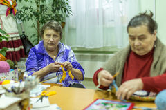 Elderly people during occupational therapy for eldery and disabled in rehabilitation department in Center of social services Royalty Free Stock Images