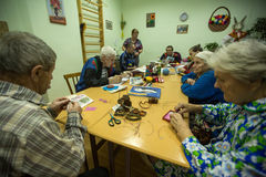 Elderly people during occupational therapy for eldery and disabled in rehabilitation department in Center of social services Royalty Free Stock Photography