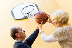 Elderly people playing with ball Royalty Free Stock Image