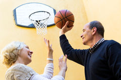 Elderly people playing with ball Stock Photos