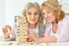 Elderly people playing a board game Royalty Free Stock Photography