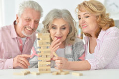 Elderly people playing a board game Stock Images