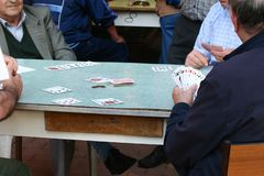 Elderly people playing cards. During a itailan fair Stock Photography