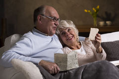 Elderly people reading old letters Stock Image