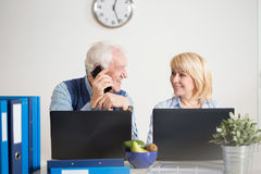 Elderly people running a company Stock Images