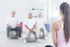 Elderly people sitting on balls Stock Photo