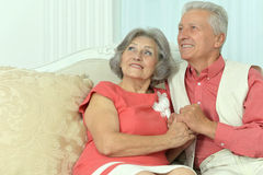 Elderly people sitting on couch Stock Photos