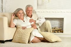 Elderly people sitting at home. Two elderly people sitting at home on couch Royalty Free Stock Photos