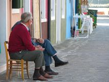 Elderly people talking. In Burano venice Italy stock images