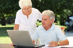 Elderly people and technology Royalty Free Stock Photos