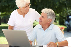 Elderly people and technology Stock Image