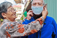Elderly people to wear a mask Stock Photos