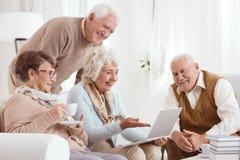 Elderly people using computer stock photos