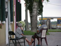 Elderly people waiting. In Burano venice italy stock images