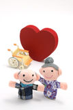 Elderly people with wheelchair and heart shape  on white background. Royalty Free Stock Photo