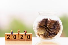 Elderly people and wood block word 2020 on nature background. royalty free stock image