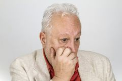 Elderly person in desperation. On bright background Stock Photography
