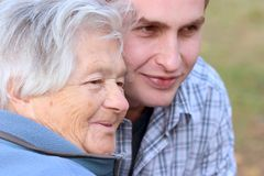 Elderly person and grandson stock photography