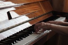 Elderly person hands playing the piano, close up royalty free stock photography