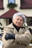 Elderly person and her house Stock Photo