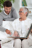 Elderly person looking at photos Stock Image