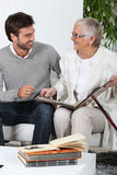 Elderly person looking at photos Royalty Free Stock Photography