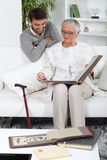 Elderly person looking at photos Stock Images