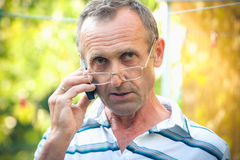 Elderly person with the mobile phone Royalty Free Stock Image