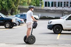 Elderly person on the segway royalty free stock photos