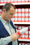 Elderly person selects goods in food store Stock Image