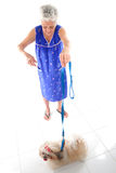 Elderly and a Pet. Elderly with her pet on white floor stock photos