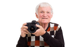 Elderly photographer with camera Royalty Free Stock Photography