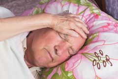 Elderly 80 plus year old man in a home bed. Illness, aging, unhealthy concepts Royalty Free Stock Photos