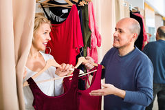 Elderly positive  woman dressing in changeroom of clothing store Royalty Free Stock Image