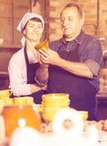 Elderly potters at ceramic workshop stock image