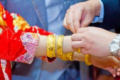 Elderly relatives presenting the golden bracelet Stock Photos